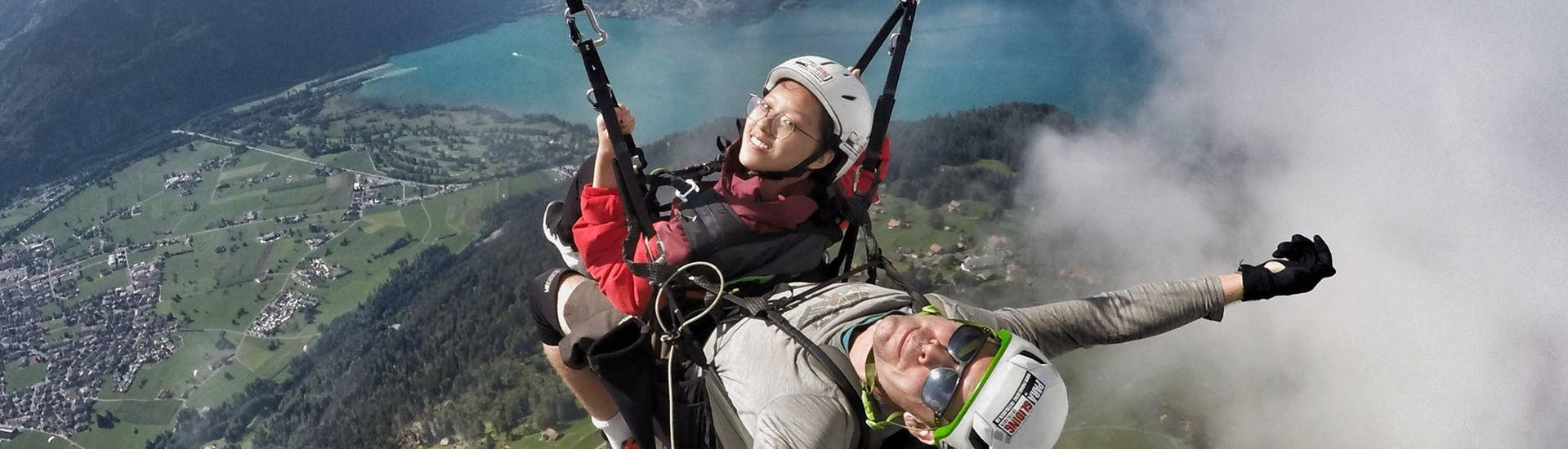 "During the Tandem Paragliding ""Big Blue"" - Jungfrau Massive with Paragliding Interlaken, a passenger and her certified tandem pilot are enjoying the fantastic view over Interlaken."