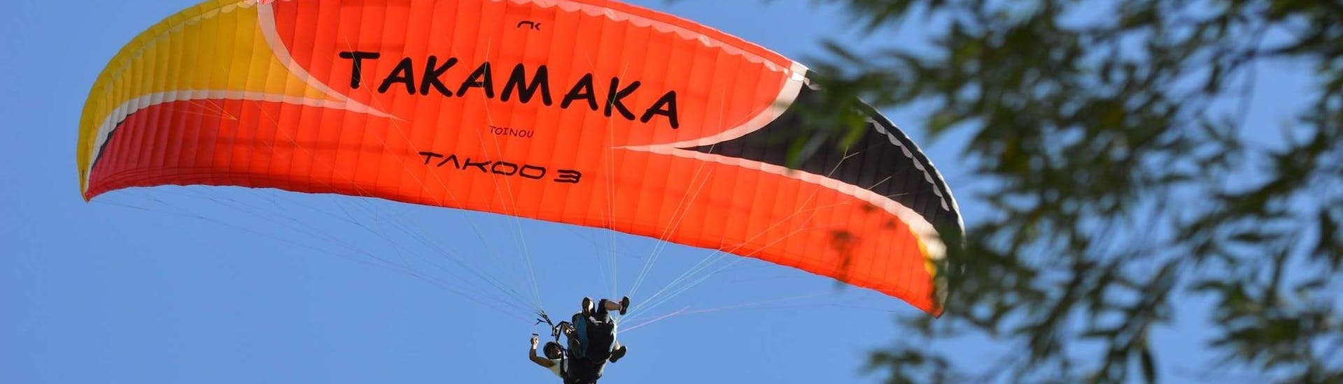 """Paragliding glider in the colors of Takamaka Aix Les Bains like the one used for a Tandem Paragliding """"Adrenaline""""."""