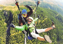 """A tandem master and his passenger are enjoying the views while taking part in Tandem Paragliding """"Adventure"""" - Zermatt provided by Flybypara."""