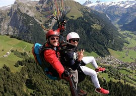 A tandem pilot from Mountain O'Clock and his passenger are flying over the mountainous scenery of Switzerland during their Tandem Paragliding at Lake Lucerne - Taster Flight.