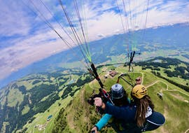 A tandem pilot from TirolAir and his passenger are enjoying the spectacular scenery while paragliding from the Hohe Salve.