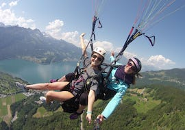 """During the Tandem Paragliding """"Heidi's Flight"""" at Beatenberg with Paragliding Interlaken, a certified tandem pilot and her passenger are enjoying the spectacular view over Interlaken."""