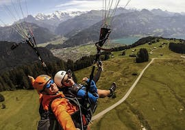 """A tandem pilot from Skywings Interlaken and his passenger are seemingly enjoying themselves during the activity Tandem Paragliding in Interlaken - """"The Sensational""""."""