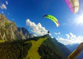 The tandem pilot of Fly-Stubai flies over a beautiful mountain panorama during the tandem paragliding in Stubai - high altitude flight.