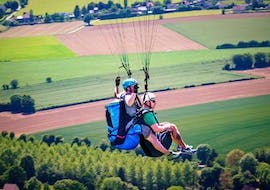 """A man is enjoying his Tandem Paragliding """"Norman Switzerland"""" - Normandie activity with Parapente Mania."""