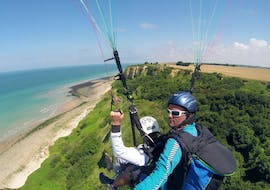 "A man is enjoying his Tandem Paragliding ""Omaha Beach"" - Normandie with Parapente Mania."