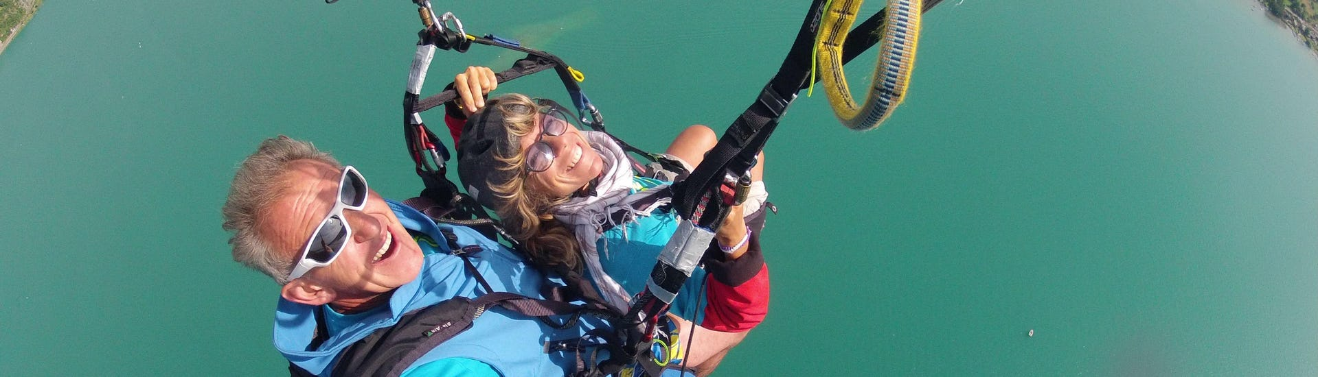 A woman is enjoying her Tandem Paragliding at Lake Annecy - Optimum activity with FBI Parapente.
