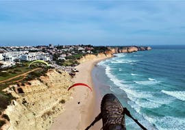 While Tandem Paragliding at Praia do Porto de Mós with Flytrip, passengers can enjoy the beautiful view of the beach and the ocean.