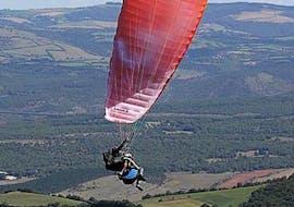 "A man is enjoying his Tandem Paragliding ""Sensation"" - Millau activity with Air Magic Parapente."