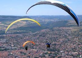 """Two persons are enjoying their Tandem Paragliding """"XL"""" - Millau activity with Air Magic Parapente."""