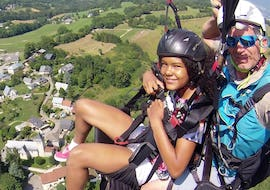 A kid is enjoying their Tandem Paragliding Discovery Kids with Prevol Paragliding.