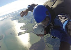 A tandem student and their instructor from Skydive Auckland are taking in the impressive bird's-eye view during their Tandem Skydive in Auckland - 13,000ft.