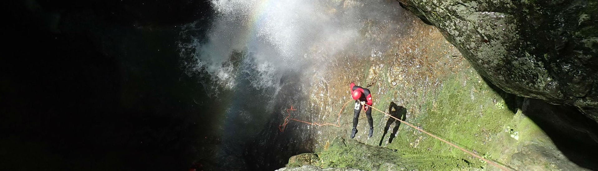 A canyoning enthusiast descends into a gorge by abseiling during a canyoning tour organised by Terréo Canyoning.