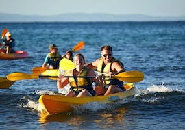 A young couple is all smiles during a tour by sea kayak from Noosa with Epic Ocean Adventures Noosa.