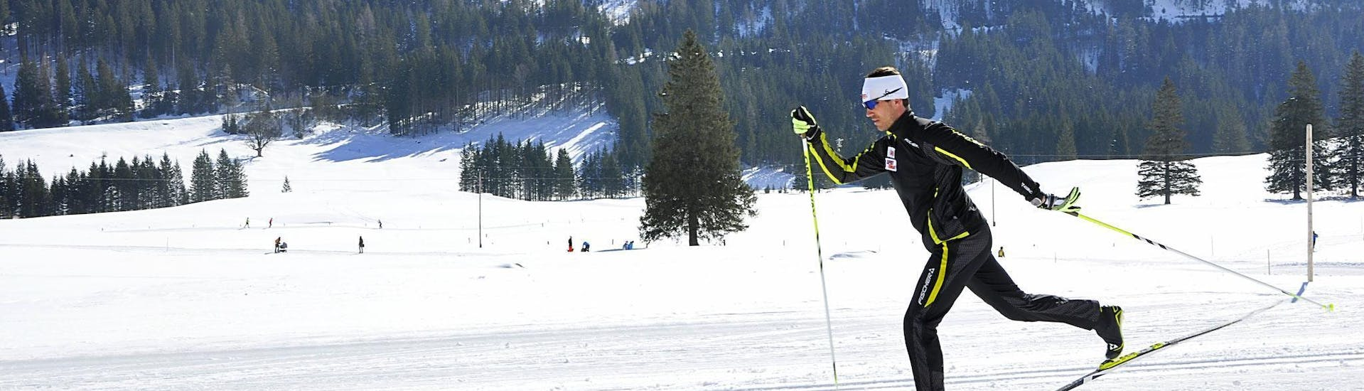 A man rides through the fresh tracks together with the guides from Langlaufschule Gnadenalm during his Trial Cross Country Skiing Lessons for All Levels.