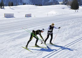 A guide of Langlaufschule Gnadenalm teaches his student the correct technique during the Trial Cross Country Skiing Lessons for All Levels.