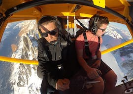 The pilote is commenting the landscapes during a Ultralight Aircraft Flight over the Chamonix Valley.