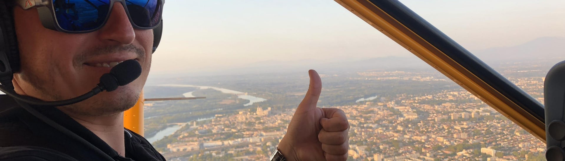 The tourist is happy to pilot Ultralight Aircraft Flight above the Mer de Glace