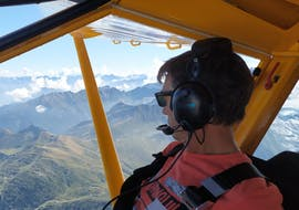The tourist is contempling the landscapes during his Ultralight Aircraft Flight above the Mer de Glace.