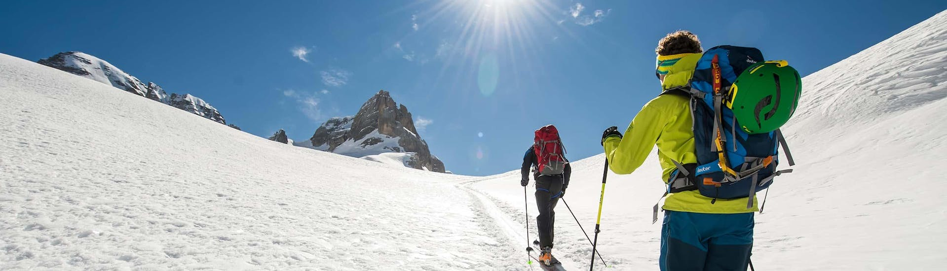 A skier following his Private Ski Touring Guide for All Levels from Ski School Stuben up to the top of the mountain while out ski touring.