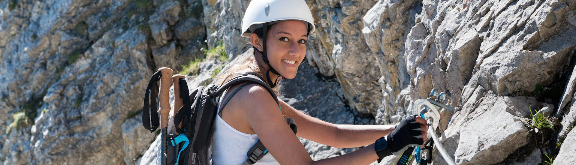 Woman climbing on a Via Ferrata