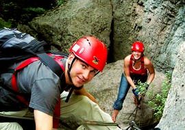 A girl is facing a via ferrata with Skyclimber's guide during the Via Ferrata Rio Sallagoni First Experience.