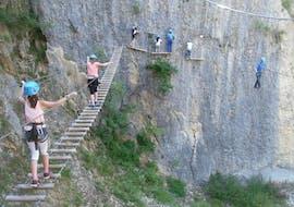 """A family is doing the Via Ferrata """"Roche au Dade"""" - Morez activity with La Boîte à montagne."""