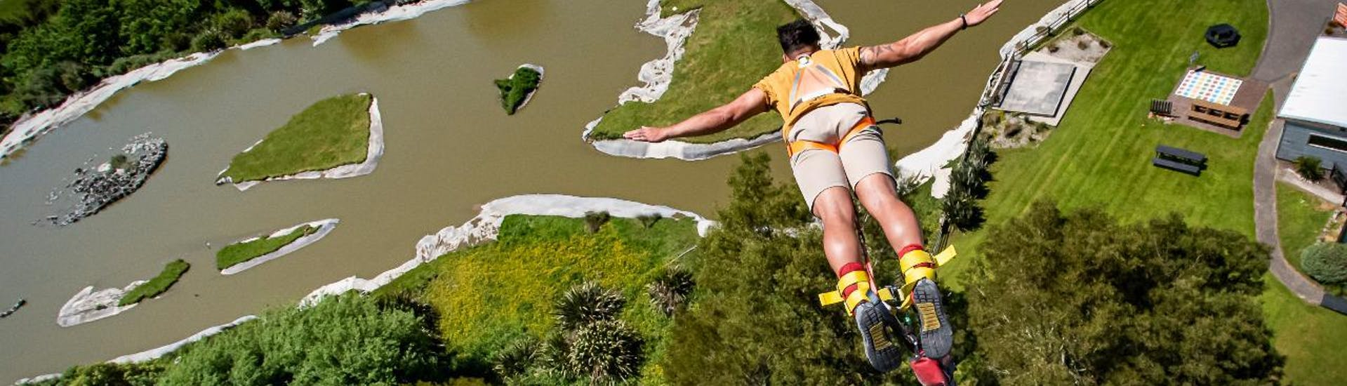 With a VIP Adrenaline Package with Bungy Jump in Rotorua, one happy customer is hurling to the grounds during an adrenaline-packed jumping of a 43m high tower in Velocity Valley Rotorua Adventure Park.