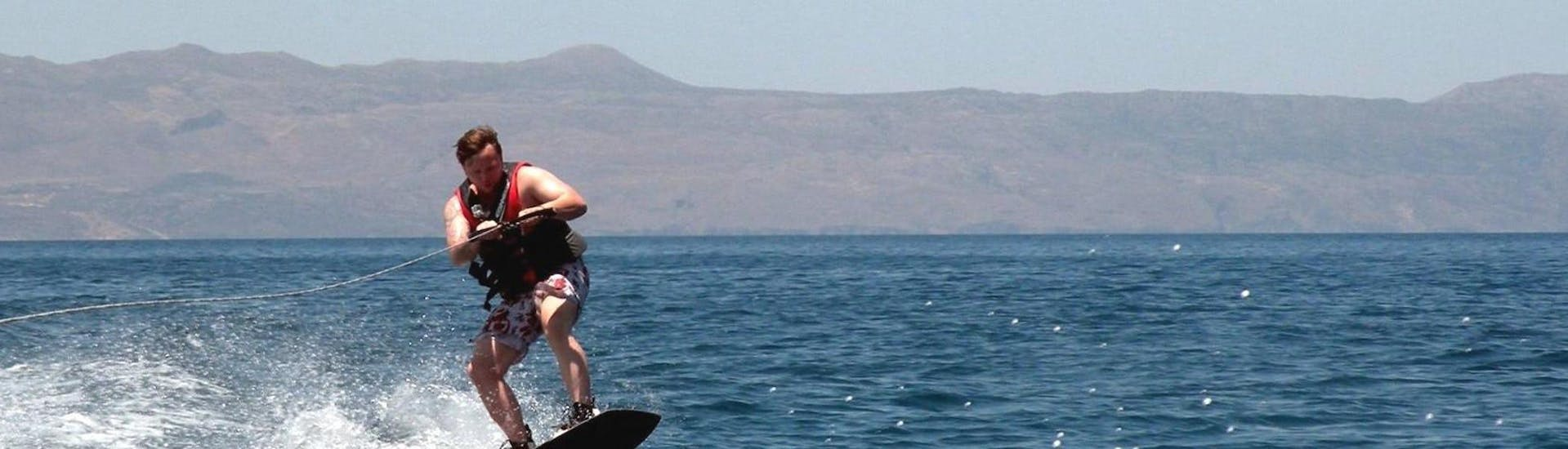A person is enjoying his Wakeboarding in Agia Marina activity with Cactus Water Sports Center.