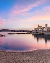 Panoramic view of the sunset from Plage de la Gravette, where many people come to do water sports in Antibes.