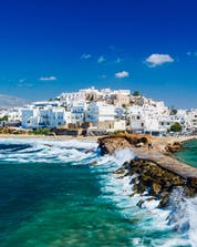 An image of the old port with its characteristically white buildings, a popular place to do water sports in Naxos.