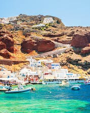 An image of the old port in Oia, a popular place to do water sports in Santorini.