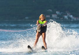 A woman is pulled by a boat during her Waterskiing Lessons on Lake Annecy with Le Spot.