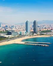 The impressive and beautiful view of the city and the shore where you can practice different water sport activities in Barcelona.