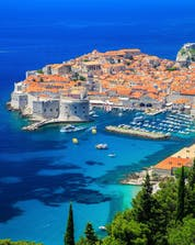 A wide view of a city-coast in Croatia where you can do water sport activities in Durbrovnik.