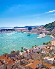 A view from above from a city on the oceanside where you can do water sport activities in Split.