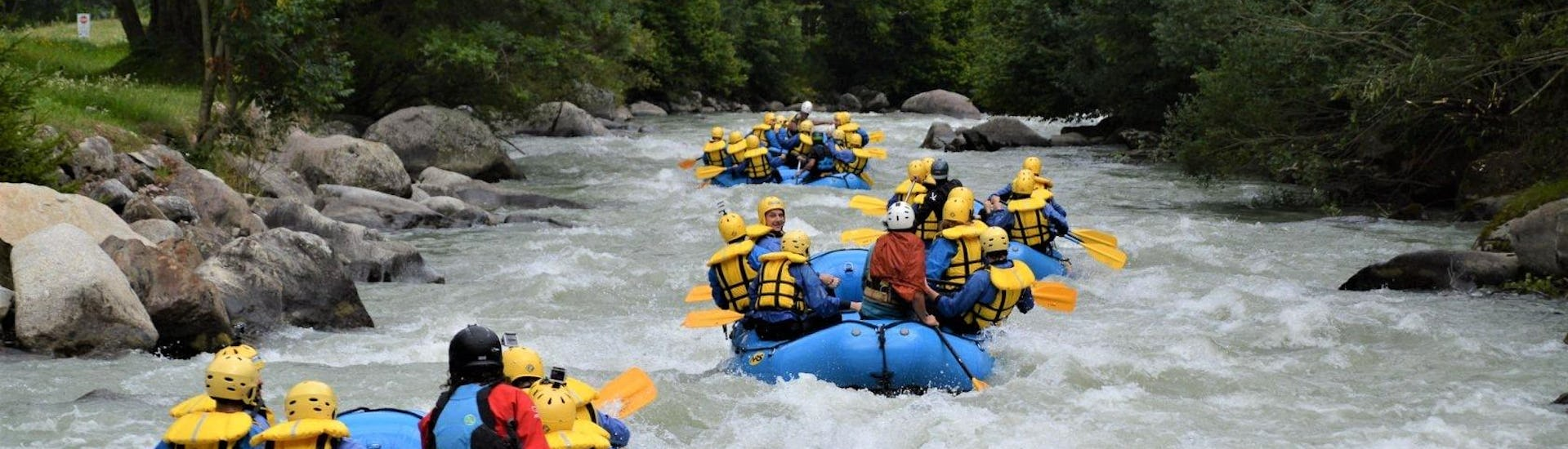 Some rafts are going down the river Noce during one of the rafting activities organized by X Raft Val di Sole.
