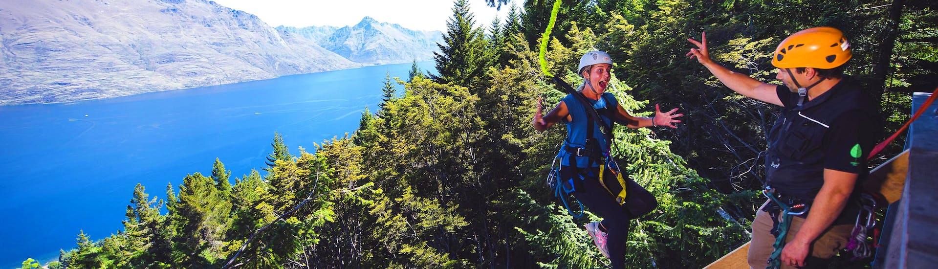 A girl looks at the difference in altitude below her, soon he will jump 21 m, which is the highlight of the Zipline route in Queenstown - Kereru: 2 Ziplines and 21 m Drop of Ziptrek Ecotours Queenstown.