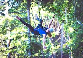 A girl has fun on the zipline during the Zipline experience in Queenstown - Kea: 6 Lines offered by Ziptrek Ecotours Queenstown.