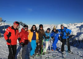 The group of skiers are taking a break during the Adults Ski Lessons with Altitude Ski School Verbier & Gstaad.