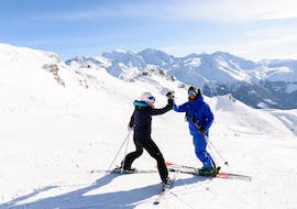 Two skiers are satisfied of their performance during the Private Ski Lessons for Adults in Verbier with Altitude Ski School Verbier & Gstaad.