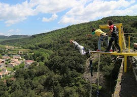 """A person is participating to the Tandem Bungee Jumping """"Seajump"""" from Viaduc Boussagues (50m) activity with Elastic Natural Bungee."""
