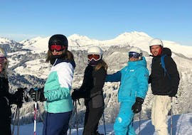 Skiers are standing in front of a snow-covered mountain landscape during their Ski Lessons for Adults - Morning - Beginner - High Season with the ski school ESI Easy2Ride Morzine.