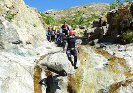 A group is jumping in the Zoicu Canyon during the Canyoning Sport with Canyon Corse.