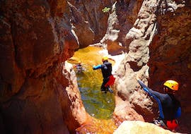 A tourist is jumping canyon du baracci during the Canyoning discovery with Canyon Corse.