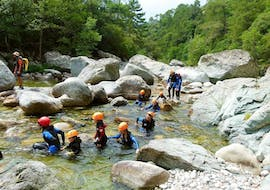 A family is swimming in the Vecchio canyon during the Canyoning for families with Canyon Corse.
