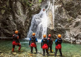 A group is contemplating the canyon du Verghellu during the Canyoning Sport with Canyon Corse.