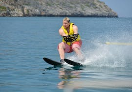 A person is enjoying his Waterskiing in Agia Marina activity with Cactus Water Sports Center.