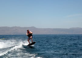A person is participating to Wakeboarding in Agia Marina activity with Cactus Water Sports Center.