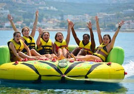A group of friends is enjoying their Sofa Ride and Tour in Agia Marina activity with Cactus Water Sports Center.